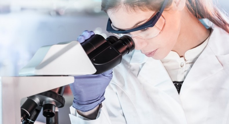 500px Photo ID: 215230985 - Life scientists researching in laboratory. Attractive female young scientist microscoping in their working environment. Healthcare and biotechnology.